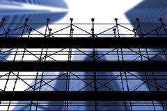 Composite image of 3d image of construction scaffolding. 3d image of construction scaffolding against low angle view of skyscrapers in city Stock Photo