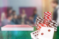 Composite image of 3d image of dice. 3D image of dice against people placing bets on roulette table Stock Photo