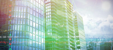 Composite image of 3d image of glass buildings. 3d image of glass buildings against stocks and shares Stock Photo