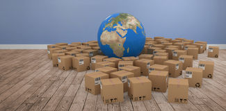 Composite image of 3d image of globe amidst cardboard boxes. 3D image of globe amidst cardboard boxes against room with wooden floor Stock Image