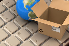 Composite image of 3d image of globe by empty cardboard box. 3D image of globe by empty cardboard box against finger pressing enter key Stock Photo