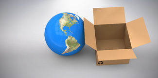 Composite image of 3d image of globe with empty cardboard box. 3D image of globe with empty cardboard box against grey background Royalty Free Stock Photo