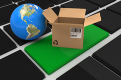 Composite image of 3d image of globe with open cardboard box. 3D image of globe with open cardboard box against black keyboard with green key Stock Photo