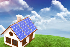 Composite image of 3d image of house with solar panels Stock Images