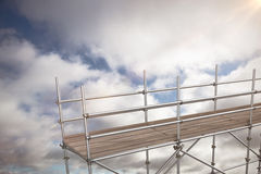 Composite image of 3d image of metal structure against white background. 3d image of metal structure against white background against blue sky with clouds Royalty Free Stock Photos