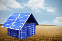 Composite image of 3d image of model home made from solar cells and panels. 3d image of model home made from solar cells and panels against bright brown Stock Image