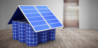 Composite image of 3d image of model home made from solar cells and panels. 3d image of model home made from solar cells and panels against room with elevator Royalty Free Stock Photo