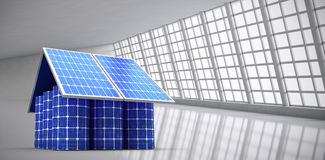 Composite image of 3d image of model home made from solar panels and cells Royalty Free Stock Photo