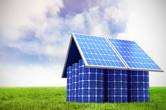 Composite image of 3d image of model home made from solar panels and cells. 3d image of model home made from solar panels and cells against blue sky over green Royalty Free Stock Photography