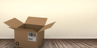 Composite image of 3d image of open courier cardboard box. 3D image of open courier cardboard box against room with wooden floor Stock Photography