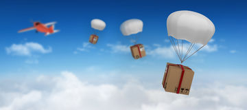 Composite image of 3d image of parachute carrying cardboard box Stock Image