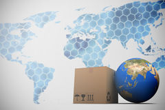 Composite image of 3d image of planet earth and box. 3D image of planet Earth and box against background with hexagons and world map Royalty Free Stock Photo