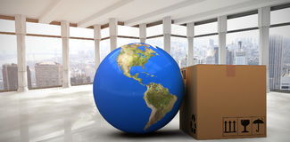 Composite image of 3d image of planet earth by cardboard box Stock Images