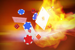 Composite image of 3d image of playing cards with dice and casino tokens. 3D image of playing cards with dice and casino tokens against defocused image of Royalty Free Stock Image