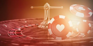 Composite image of  3d image of red casino token with hearts symbol. Vector 3D image of red casino token with hearts symbol against orange background with Royalty Free Stock Photo