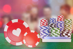 Composite image of  3d image of red casino token with hearts symbol. Vector 3D image of red casino token with hearts symbol against winner and loser at roulette Stock Images