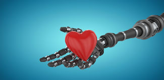 Composite image of 3d image of robot hand holding heard shape decoration 3d. 3d image of robot hand holding heard shape decoration against blue vignette Royalty Free Stock Images
