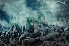 Composite image of 3d image of several damaged symbols with stones. 3d image of several damaged symbols with stones  against composite image of graphs Stock Photography