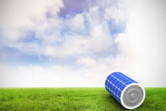 Composite image of 3d image of solar battery. 3d image of solar battery against blue sky over green field Stock Image