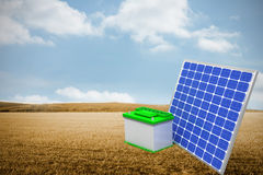Composite image of 3d image of solar panel with battery. 3d image of solar panel with battery  against bright brown landscape Royalty Free Stock Images
