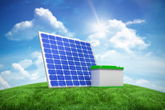 Composite image of 3d image of solar panel with battery. 3d image of solar panel with battery against green hill under blue sky Stock Image