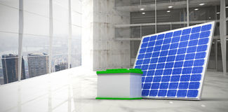 Composite image of 3d image of solar panel with battery. 3d image of solar panel with battery against modern room overlooking city Stock Photos