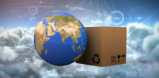 Composite image of 3d planet earth and cardboard box against white background Royalty Free Stock Images