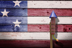 Composite image of 3D rocket for fireworks. 3D Rocket for fireworks against composite image of usa national flag Stock Image