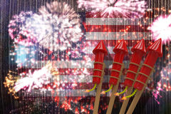 Composite image of 3D rockets for fireworks. 3D Rockets for fireworks against colourful fireworks exploding on black background Royalty Free Stock Image