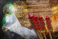 Composite image of 3D rockets for fireworks. 3D Rockets for fireworks against colourful fireworks exploding on black background Stock Photography