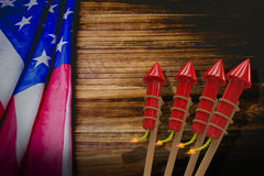 Composite image of 3D rockets for fireworks. 3D Rockets for fireworks against usa flag on table Royalty Free Stock Images