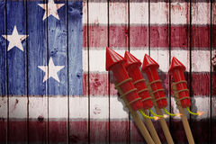 Composite image of 3D rockets for fireworks. 3D Rockets for fireworks against composite image of usa national flag Stock Images