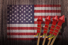 Composite image of 3D rockets for fireworks. 3D Rockets for fireworks against composite image of usa national flag Royalty Free Stock Images
