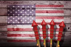 Composite image of 3D rockets for fireworks. 3D Rockets for fireworks against composite image of usa national flag Royalty Free Stock Photo