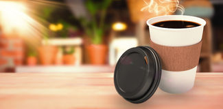 Composite image of dark coffee on white cup over white background Royalty Free Stock Images