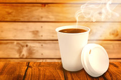 Composite image of dark coffee on white cup over white background Stock Images