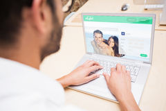 Composite image of dating website. Dating website against men using laptop royalty free stock photos