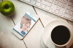 Composite image of dating website. Dating website against smartphone on table royalty free stock photos