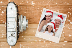 Composite image of daughter, mother and grandmother baking christmas sweets Stock Photo