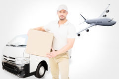 Composite image of delivery man carrying cardboard box Royalty Free Stock Photo
