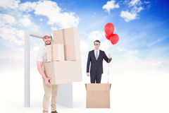 Composite image of delivery man carrying cardboard boxes Stock Image