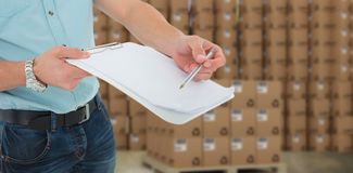 Composite image of delivery man with clipboard asking for signature Royalty Free Stock Images
