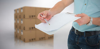 Composite image of delivery man with clipboard asking for signature Royalty Free Stock Photo