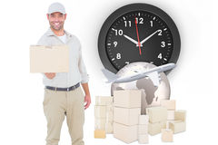 Composite image of delivery man giving package on white background Stock Photo