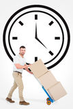 Composite image of delivery man pushing trolley of boxes Royalty Free Stock Image