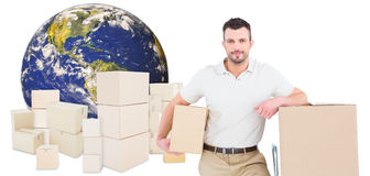 Composite image of delivery man with trolley of boxes Royalty Free Stock Photo