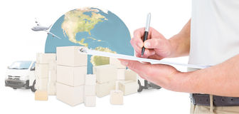 Composite image of delivery man writing on clipboard Royalty Free Stock Images