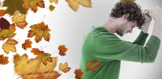 Composite image of depressed man over white background Stock Photos