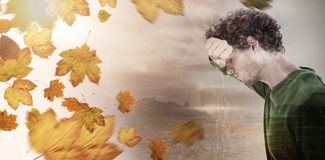Composite image of depressed man over white background Royalty Free Stock Photo