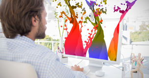Composite image of desinger working on his computer royalty free stock photography